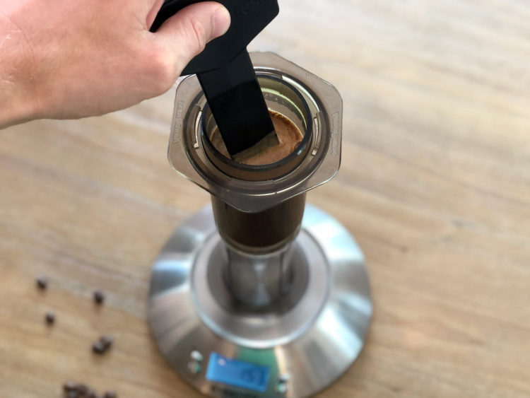 Slowly and continuously add the remaining water to the coffee