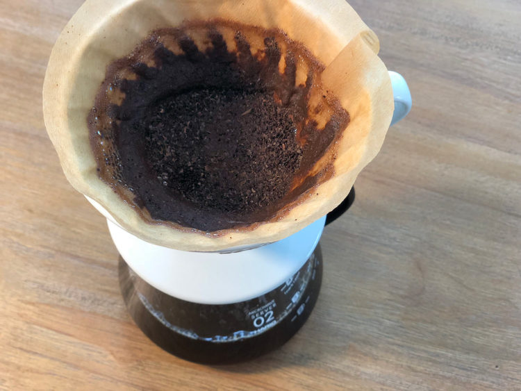 Allow water to fully drain through coffee