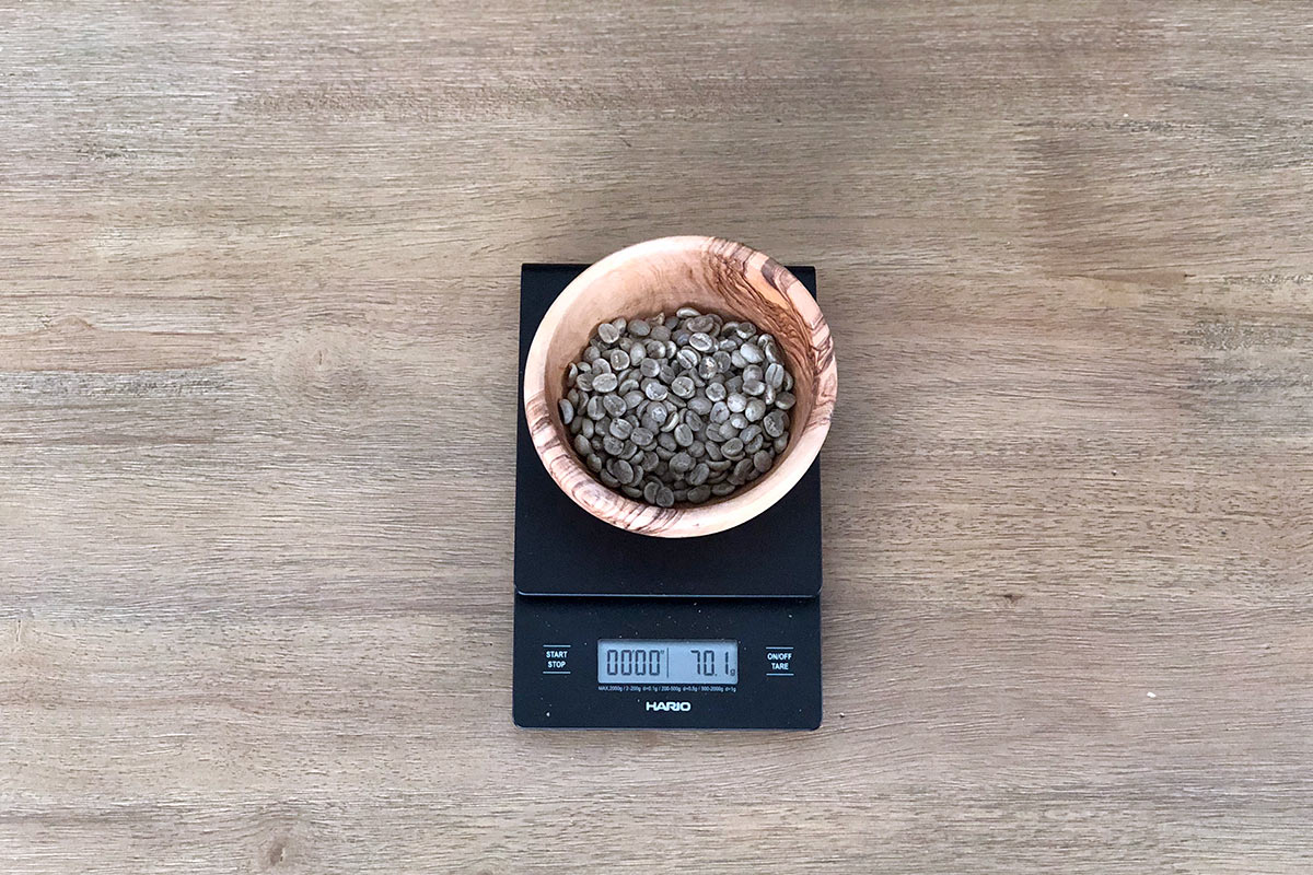 Green coffee beans on a scale