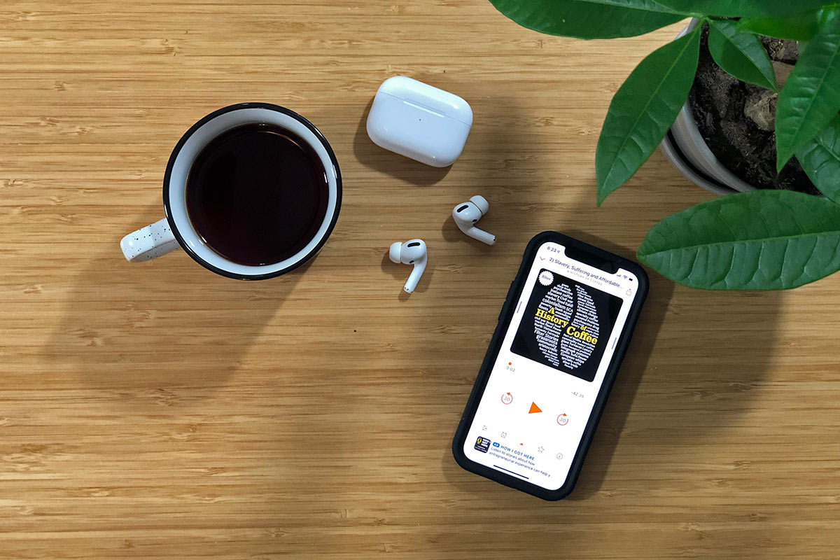 iPhone with A History of Coffee podcast playing on the screen