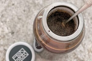 Stirring coffee grounds in cold brew coffee maker