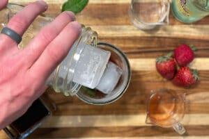 Adding ice for Strawberry Mojito Cold Brew Cocktail