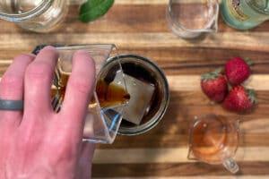 Adding cold brew for Strawberry Mojito Cold Brew Cocktail