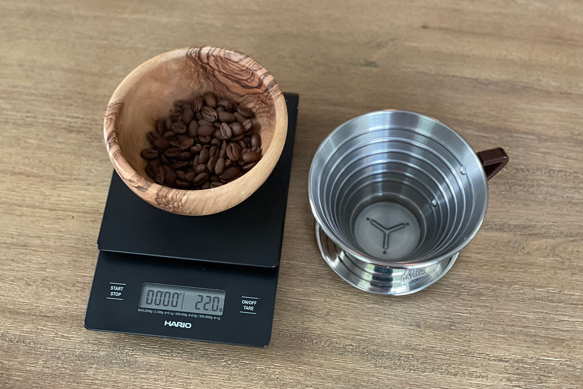 Kalita 185 brewer with coffee beans